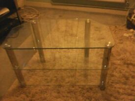 A VERY THICK GLASS TV STAND