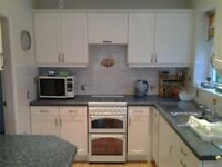 Stoves Newhome Gas Cooker. 55cm. 4 rings, battery ignition. Glass door to grill and oven, glass top.
