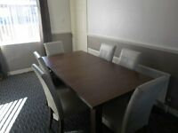DINING ROOM TABLE AND 6 LEATHER CHAIRS, EXCELLENT CONDITION , SELLING AS MOVING TO SMALLER PREMISES