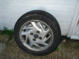 A pair of Fiat Seicento wheels and tyres