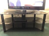 Black glass TV stand for sale for £35. Available for collection from today.