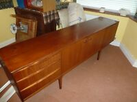 McIntosh teak sideboard,3 drawers,drinks cabinet section and storage section with asymetric shelf