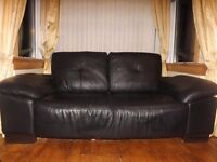 4Seater and 3 seater black leather sofas, good condition adjustable arms dark wood feet £275