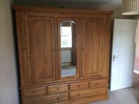 Triple door solid pine wardrobe with 6 drawers