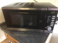 Black / silver microwave. Can deliver.