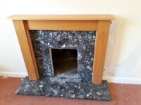 Marble hearth and surround, and wood mantlepiece. Good condition.