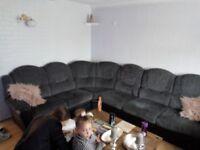 Large grey and black corner sofa