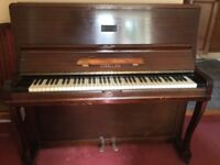 Piano, free, buyer to collect.
