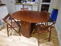 Folding table and four chairs with storage - ideal for a small kitchen / dining area