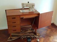 Vintage Singer Electric Sewing Machine model 449, in teak style cabinet.