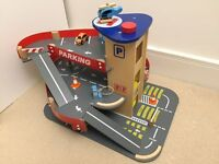 ELC wooden toy car garage with lift, helicoptor, cars, etc.