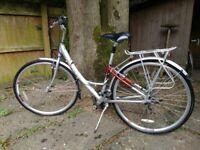 Ladies Raleigh Pioneer cycle, medium size frame, 21 speed Shimano gears, carrier, hardly used.