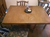 Solid oak table with leaf and 4 chairs