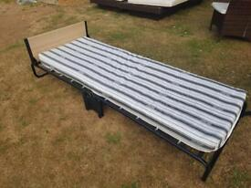 Single Foldable Bed - used once!!