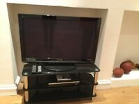 Panasonic plasma TV, stand and video player