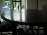 ERCOL OLD COLONIAL SOLID ELM DINING TABLE AND FOUR CHAIRS