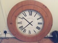 Giant clock with pine surround