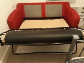 Bright red sofa bed