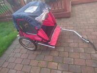Kids bike trailer holds 2 children