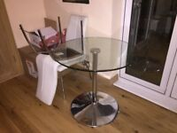 Glass table and 2 white chairs