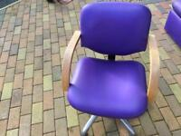 Purple swivel hairdressing chair