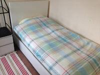 Bedroom including single bed, mattress, bedside table, wardrobe