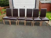 6 brown fuax leather chairs