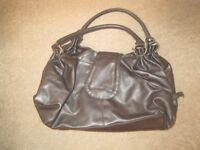 Medium sized dark brown handbag