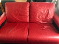 Stunning two seater red leather sofa