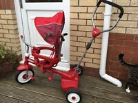 Radio Flyer Ride and Stroll and stand trike