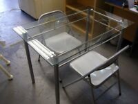 Glass Topped Dining Table with 2 Ikea Metal Folding Chairs