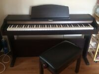 Roland HP 101 electronic/digital piano with stool