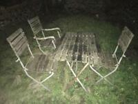 Garden furniture table with four chairs. Slated wood with cast iron.
