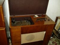 vintage record player in builtin wooden cabinet