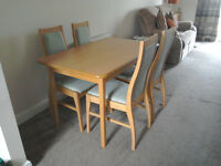 Light wood dining table and 4 chairs