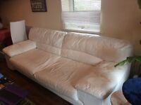 White leather 3 seater settee including a free good quality white rug!