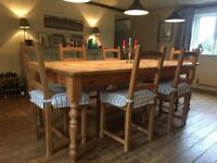 Beautiful solid wood table and 8 chairs. 7ft x 3ft can seat 10. Pretty turned solid wood legs.