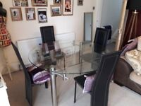 Glass table, 4 black leather chairs
