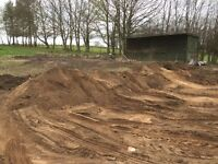 Sand. Very large quantitys free for uplift. Have jcb so can fill a trailer etc.