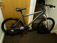 Carrera mountain bike with 26 wheel size and 20 inch frame size