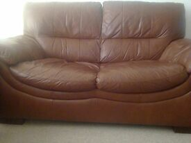 Leather sofa with recliner armchair
