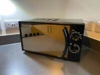 SOLD Russell Hobbs 17 Litre Piano Black Manual Microwave