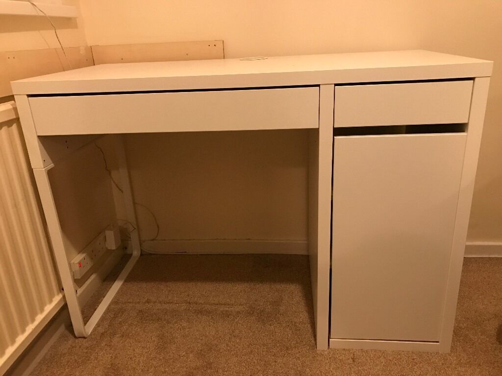 IKEA DeskWhitein Oadby, LeicestershireGumtree - Very good condition. Cable outlet at the back. You can mount the storage unit to the right or left, according to your space or preference. Assembled size Width 105 cm Depth 50 cm Height 75 cm