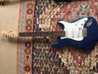 Aria STG-series electric guitar & Peavy amp