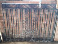 Heavy duty wrought iron gates with fixings.