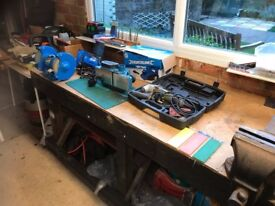 Several items for sale: Work bench with engineers Vice,Electric Plane,Electrc rotary saw.