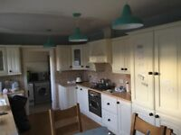 Kitchen units, oven, hob and extractor fan.