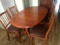 Large adjustable wooden table with 6 chairs