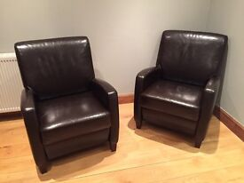 2 brown leather retro armchairs