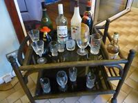 african solid bamboo framed drinks trolly,two smoked glass shelves,drinks section,pulling handle....